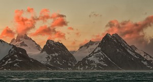 Sunset over the snow covered mountains lining the Drygalski Fjord, South Georgia