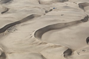 Helicopter flying over sand dunes, aerial shot, Seguta Valley, Kenya