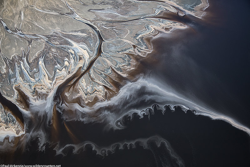 25. Crysallised salt trails on the surface of Lake Natron beside salt encrusted delta, Tanzania