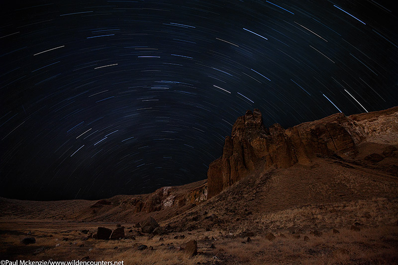 3a. Star trails over crater walls, double exposure, Central Island, Lake Turkana, Kenya